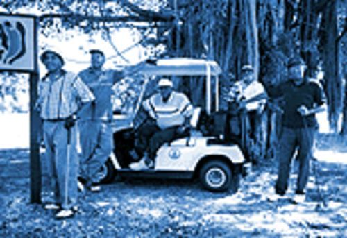Sidney Wynn and his Miami Golf Connection crew contemplate a fairway at Miami Springs