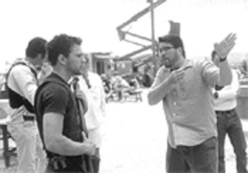 The write man for the job: Chris McQuarrie, right, directs Ryan Phillippe on the set of The Way of the Gun