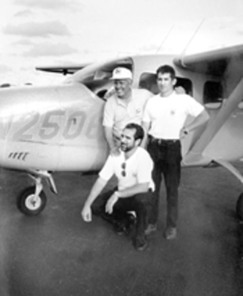 The ex-CIA agent poses with Brothers to the Rescue pilots Juan Pablo Roque and Rene Gonzalez (kneeling), both of whom happened to be Cuban agents