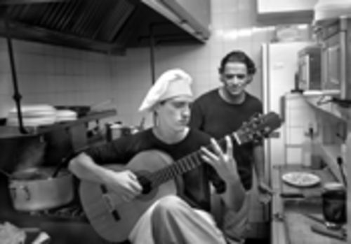 "Atilio ""Rolo"" Rodriguez looks on as his son brings harmony to the kitchen"