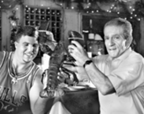 Manager George Moskos holds up a great deal for dinner at a truly hidden old Miami fish joint