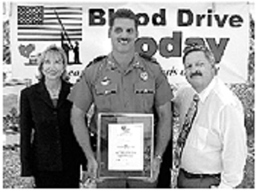 John Flynn (right), the CEO of South Florida Blood Banks, shows his community spirit