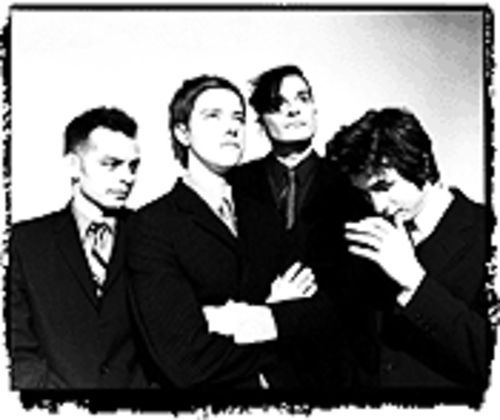 Interpol's Armani look (from left): Sam Fogarino,  Paul Banks, Carlos D, and Daniel Kessler