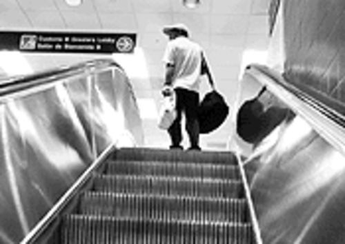 A lost passenger finds his way to the customs greeters lobby in Concourse B