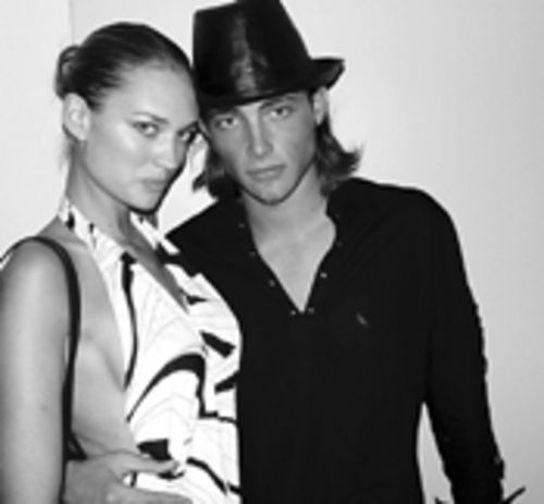 Models Amber Arbucci and Brandon strike a pose at  Mansion