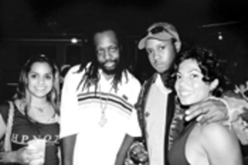 Wyclef Jean (center left) and Buggah D. Govanah  (center right) hang out with Jean's fans