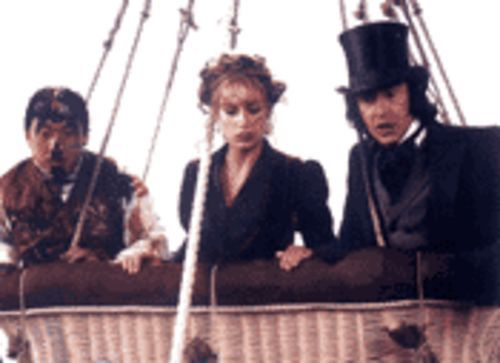Phileas Fogg (Coogan, right), femme fatale Monique  (Cécile De France, center) and a paint-addled  Passepartout (Chan, left) are in for high-flying  adventure