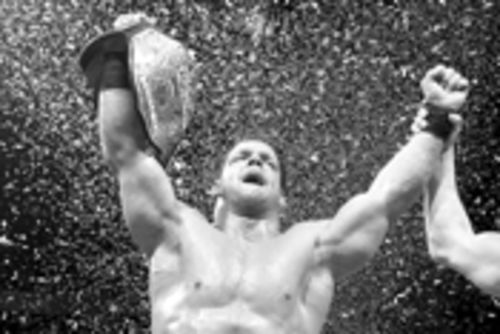 All hail the champ: WWE RAW's Chris Benoit puts on  his very big belt