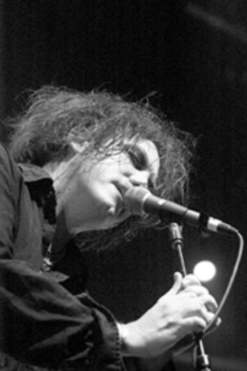 On a balmy July night, the Cure's Robert Smith preached to the converted