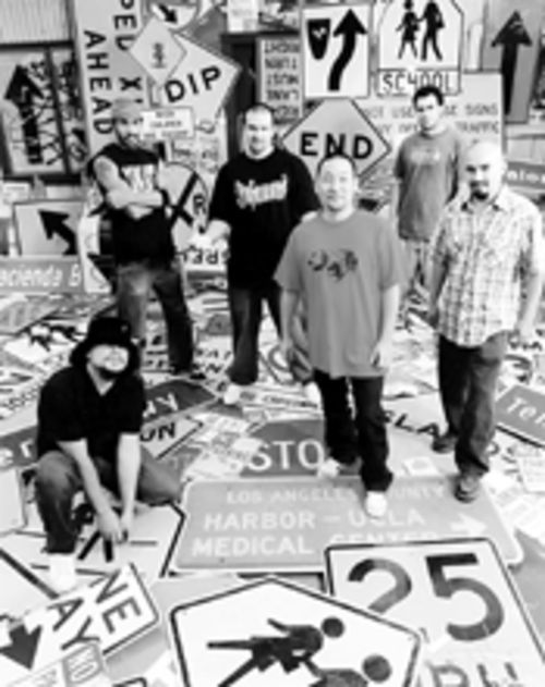 Signs of Ozomatli: Asdru (left), Justin Porée, Wil-Dog, Jiro Yamaguchi, Uli, and Raul Pacheco