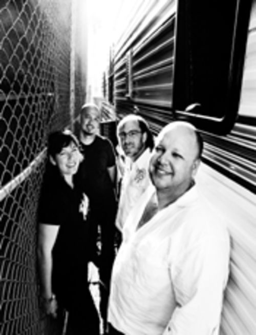 Post-grunge Pixies: Kim Deal (left), Joey Santiago, David Lovering, and Black Francis