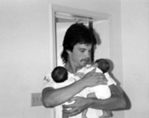 Gary holds the newborns