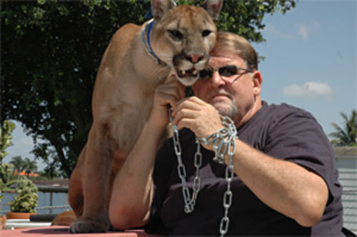 Alan Rigerman with Chaos, his cougar