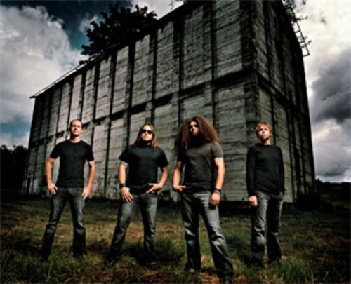 Coheed and Cambria, alone in their own world. Left to right: Joshua Eppard (drums), Travis Stever (guitar), Claudio Sanchez (vocals/guitar), and Michael Todd (bass).