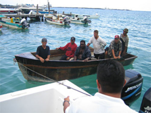 Six undocumented Cubans are towed into a marina in Isla Mujeres on the Yucatán Peninsula.