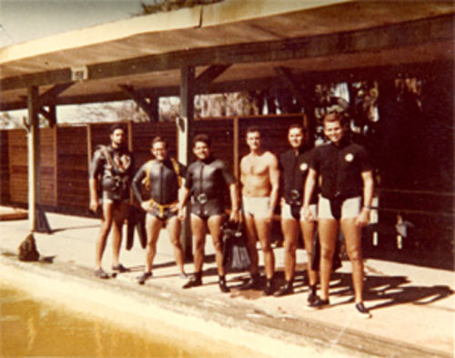Frogmen Andrés Pruna (left), Jorge Silva, Amado Cantillo, Eduardo Zayas-Bazán, Octavio Soto, and Carlos Fonts line up near a pool during their CIA-led training at an abandoned military depot shortly before the April 1961 Bay of Pigs invasion.