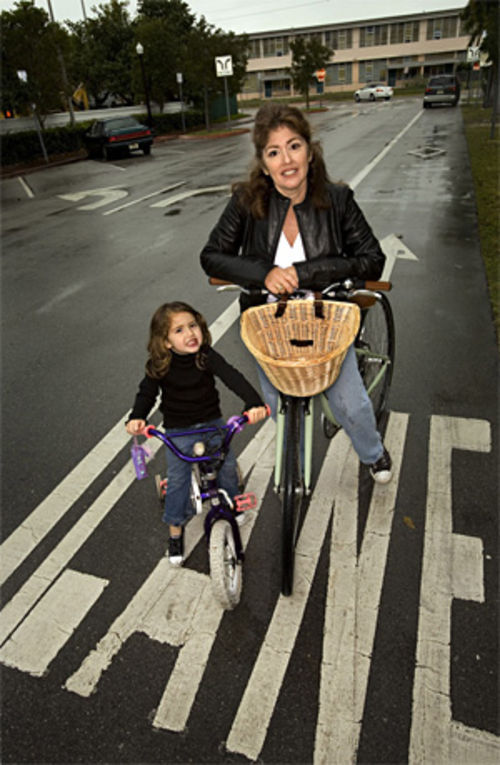 "Gabrielle Redfern, Miami Beach's one-woman bike lobby, rides with daughter Elsie along the three-block bike lane on 42nd Street. ""It goes from nowhere to nowhere. It was my first victory."""