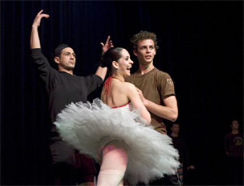 Adiarys Almeida and Taras Domitro share a laugh as another dancer looks on.