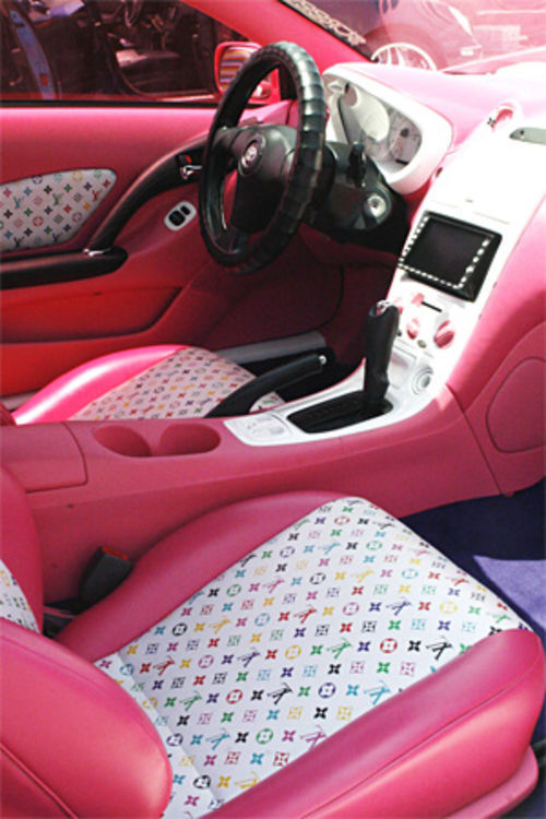 The Louis Vuitton print interior in Samantha Sunderman's pink Celica.