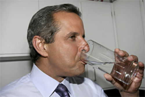 Miami Mayor Manny Diaz drinks to his health.