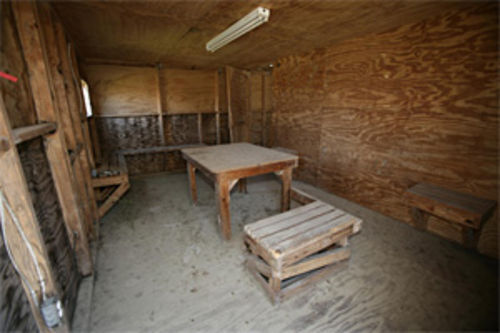Some of the worst abuses at Guantánamo might have taken place in these hastily built plywood interrogation rooms next to Camp X-Ray. They housed the first detainees at Gitmo from January to April 2002. That camp and these rooms haven't been used since.