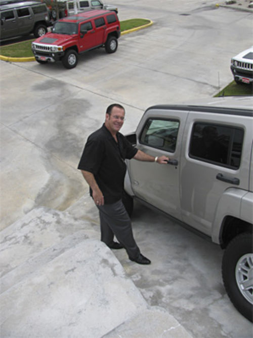 "Hummers are the anti-Prius, but car salesman Kenny Triola suggests, ""We could always put a Prius on top of an H2 and get through anything."""