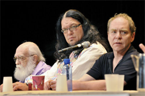 Randi (left), Penn, and Teller pose in thought during a panel discussion on magic and skepticism.