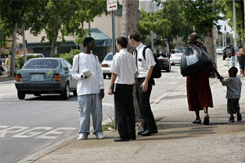 Ben Stevens and Clinton Dowse (center) spread Mormon intelligence on the streets of North Miami
