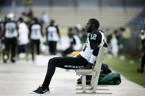 Rakeem Cato watches the defense stifle Blanche Ely en route to a 50-6 win.