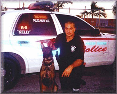 Robert Gomez poses with his K-9, Kelly