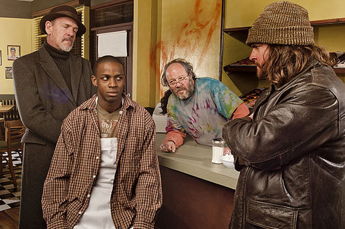 Gordon McConnell (left), Marckenson Charles, Avi Hoffman, and Paul Homza in GableStage's production of Superior Donuts.