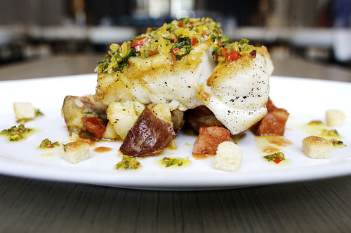 Blue Door Fish's seared grouper and crushed potatoes with chorizo. View our Blue Door Fish slide show.