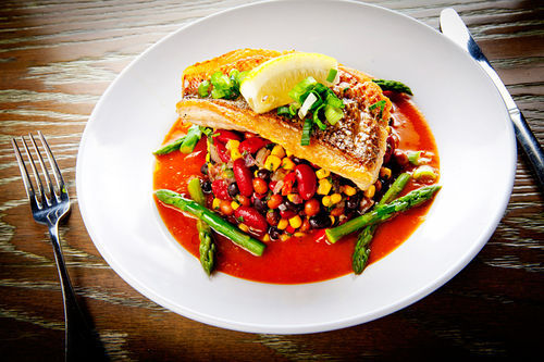 Jimmy'z red snapper with salsa and chipotle sauce. View our Jimmy'z Kitchen Wynwood slide show.