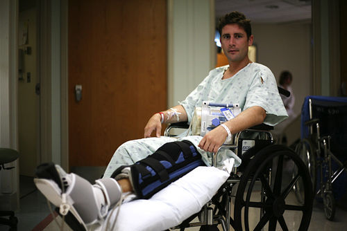 "Anthony Segrich with his ""chum bucket,"" recovering after he was attacked by a female bull shark."