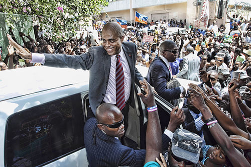Haitian President Michel Martelly waves to supporters in Port-au-Prince.