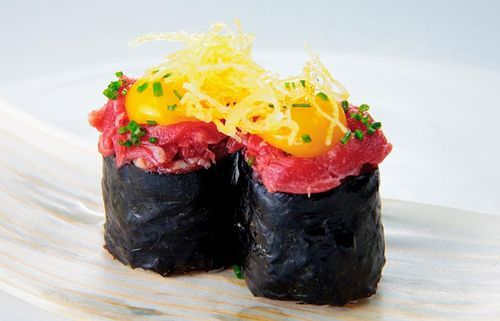 Wagyu gunkan with quail egg yolk