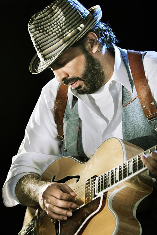 Juan Luis Guerra is a giant of Latin pop. Literally.