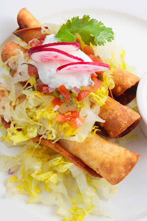 Lolita Cocina's chicken tinga flautas. View more photos of Lolita Cocina & Tequila Bar.