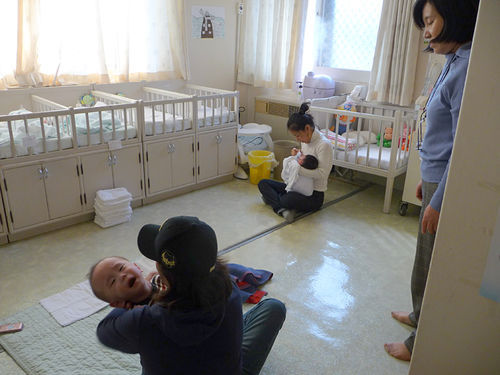 Korean Social Services director Choon Hee Kim (standing) took Chae through the orphanage where she had been sent after being given up for adoption.