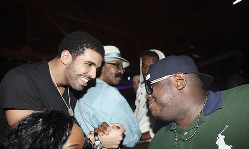 Drake greets WorldStarHipHop founder Lee O'Denat, AKA Q, at King of Diamonds.