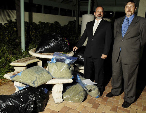 Attorneys Spencer Siegel and Thomas Wright get ready to turn over $250,000 worth of herbal incense on behalf of a client.
