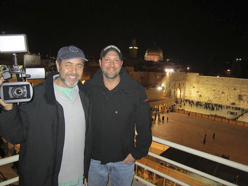 Aguiar (right) at his apartment overlooking the Western Wall with friend and filmmaker Jerry Levine.