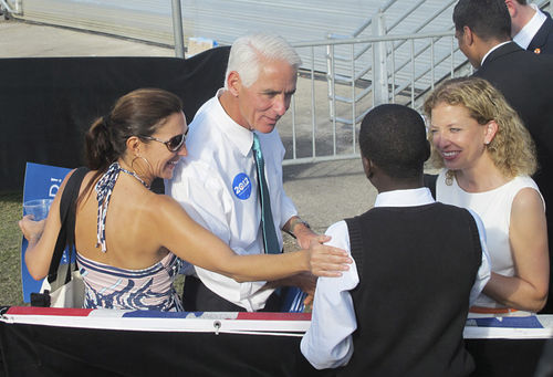 Crist, his wife Carole (bottom left), and Rep. Debbie Wasserman Schultz greet fans at a rally in Hollywood.