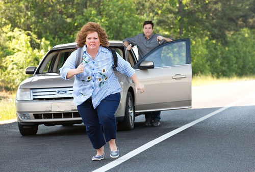 Melissa McCarthy and Jason Bateman in one of many car chases.