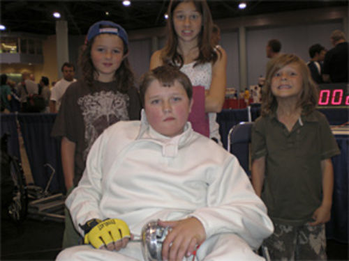 Jason Draper (center) and  his three younger siblings