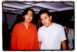 Efrain Bello and his brother Bogart in happier times.