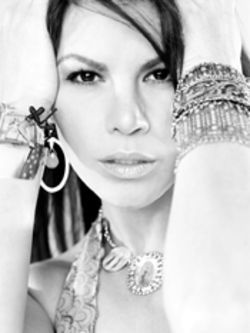 Olga Tañón: The hottest and most talented mom on   the block