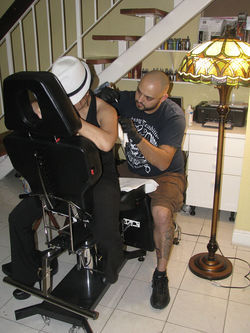 Louie tattooing Dony at his condo in Hialeah this February.