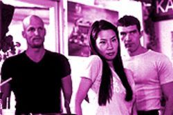Lucy Liu hits the road with Woody Harrelson and Antonio Banderas