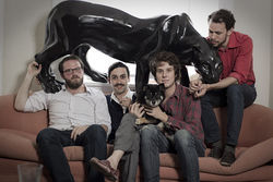The men of Animal Tropical and their pet ceramic panther, Pygmy.